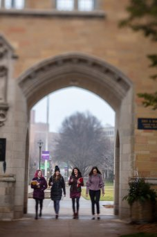Students walk through The Arches with Birdie Cunningham, associate director of Health and Wellness, on a foggy morning.