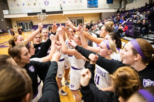 The St. Thomas women's basketball team cheers together before a game against Augsburg College. Liam Doyle/University of St. Thomas