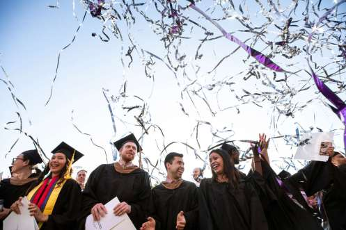 Graduates celebrate as confetti flies during the 2019 Graduate Commencement Ceremony. Mark Brown/University of St. Thomas