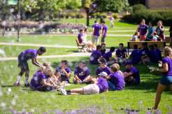 Incoming freshmen enjoy a picnic lunch following their March Through the Arches. Mark Brown/University of St. Thomas