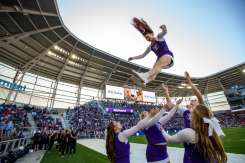 Members of the cheer team perform during the 2019 Tommie Johnnie football game at Allianz Field. Mark Brown/University of St. Thomas