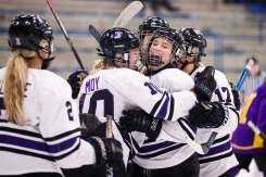 The St. Thomas women's hockey team celebrates a goal against St. Catherine University. Liam James Doyle/University of St. Thomas
