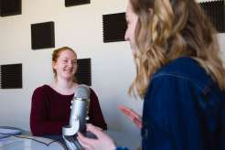Students talk in the podcast studio located in O'Shaughnessy-Frey Library. Shukrani Nangwala/University of St. Thomas
