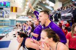 Lucas Manke cheers for his teammates during the men's and women's MIAC swimming and diving championship at the U of M Aquatic Center. Liam James Doyle/University of St. Thomas