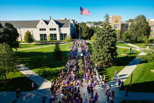 Freshmen stream across the lower quad during the March through The Arches ceremony on September 8, 2016.