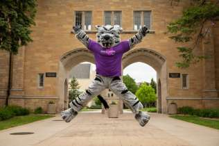 Tommie the mascot poses for a photo in front of the Arches in St. Paul on May 22, 2020.
