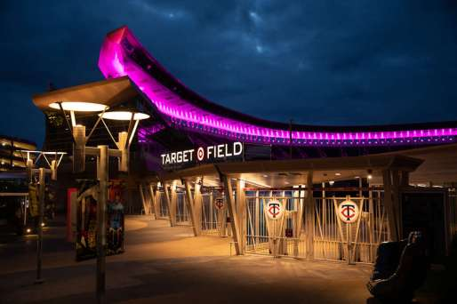 Target Field lighting is turned purple in celebration of the graduating class of 2020, in Minneapolis on May 22, 2020.
