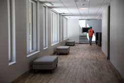 A hallway with seating in Tommie East Residence Hall.
