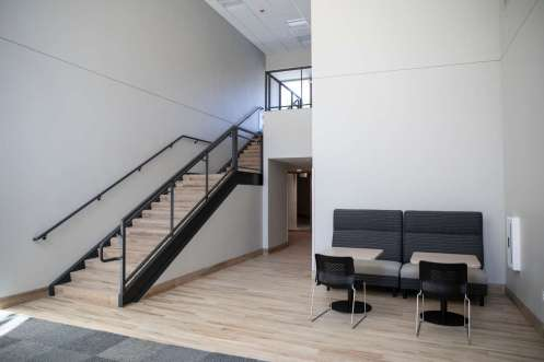 A seating space and stairway in Tommie East Residence Hall.