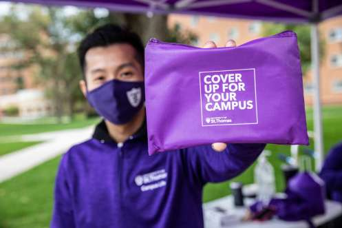 Thuy Nguyen, a graduate assistant with Campus Life, holds a care packet.