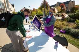 Students participate in Create Your Own Spirit Wear on Monahan Plaza as part of Homecoming Week. Mark Brown/University of St. Thomas