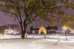 Aquinas Chapel and the Iversen Center for Faith lit up at night with lighting and lights during the first big snowfall of the year. Mark Brown/University of St. Thomas