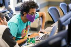 An Engineering student programs microcontrollers during a lab class in O'Shaughnessy Science Hall. Liam James Doyle/University of St. Thomas