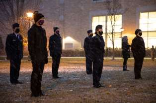 Members of Air Force ROTC Detachment 410 participate in the opening ceremony of a 24 hour vigil honoring military service members missing in action or prisoners of war. Mark Brown/University of St. Thomas