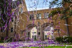 Confetti canons shooting and exploding over the Arches in celebration of the 2020 graduating class in lieu of an in-person commencement ceremony due to the coronavirus pandemic. Mark Brown/University of St. Thomas