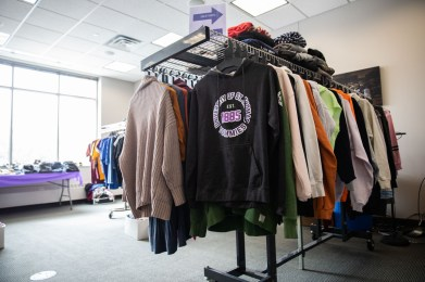 Donated clothes on racks at Tommie's Closet. Mark Brown/University of St. Thomas