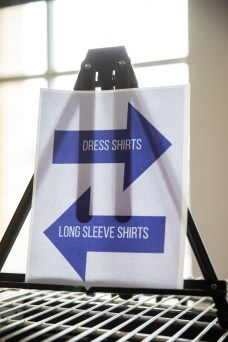A sign stands on a rack at Tommie's Closet in the Anderson Student Center. Mark Brown/University of St. Thomas
