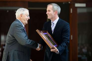 School of Law Dean Robert Vischer presents the Dignitatis Humanae Award to Walter Mondale during the School of Law Mission Awards ceremony on April 16, 2019, in the Schulze Grand Atrium of the School of Law building. (Liam James Doyle/University of St. Thomas)