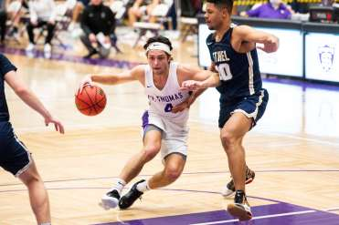 Anders Nelson pushes toward the net on March 6, 2021 at Schoenecker Arena in St. Paul where the University of St. Thomas men's basketball team defeated Bethel with a final score of 84-66. Liam James Doyle/University of St. Thomas