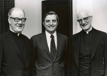 Senator Walter Mondale (center) stands with Monsignor William O'Donnell (left) and Monsignor Joseph Hughes (right) prior to receiving an honorary degree from the College of St. Thomas, 1973.