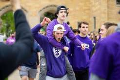 Freshman students March through the Arches.