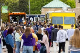 Students get food from food trucks during Tommie Fest. Mark Brown/University of St. Thomas