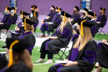 Students from the School of Law's Class of 2020 sit socially distanced at O'Shaughnessy Stadium during their Commencement ceremony. Liam James Doyle/University of St. Thomas