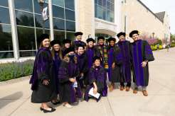 Students pose for a group photo after the School of Law Class of 2021 commencement ceremony. Mark Brown/University of St. Thomas