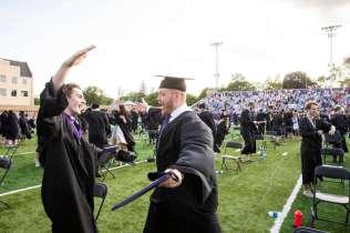 Students celebrate following the 5pm undergraduate commencement ceremony. Liam James Doyle/University of St. Thomas