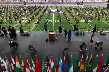 President Sullivan hands out diplomas during the 9am commencement ceremony in O'Shaughnessy Stadium in St. Paul on May 22, 2021.
