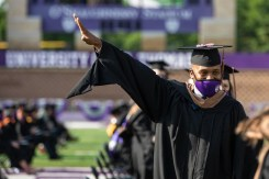 A student waves to the crowd during the commencement ceremony for graduate programs in the Opus College of Business and School of Engineering. Mark Brown/University of St. Thomas