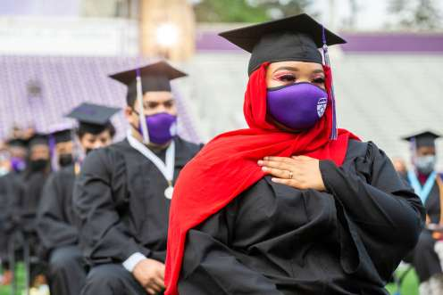 Students attend the Dougherty Family College commencement ceremony in O'Shaughnessy Stadium. Liam James Doyle/University of St. Thomas