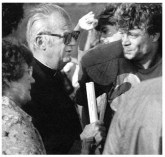 Monsignor Murphy and Gregory Murphy after a football game.
