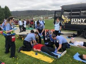 Paramedics treat a patient at the Mock Disaster
