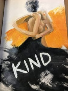 A painting with the word Kind