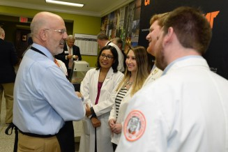 Joe DiPietro chats with students from UT Health Science Center