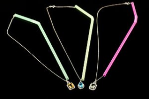 Thread necklaces through straws to keep them tangle-free when you travel