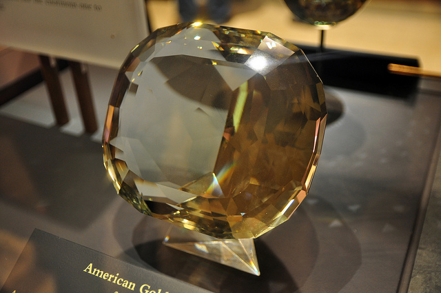 The world's largest cut topaz, the 'American Golden' from Brazil's Minas Gerais region, weighs 22,892.5 carats. Here it's seen on display at the Smithsonian in Washington, USA / Image credit via ZakVTA, Flickr.com