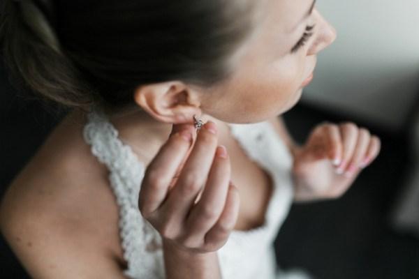 Bride wearing vintage diamond drop earrings