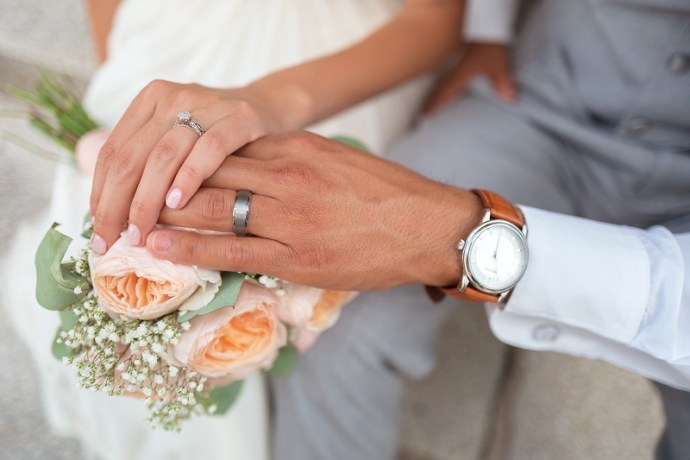 engagement ring and wedding rings on which finger