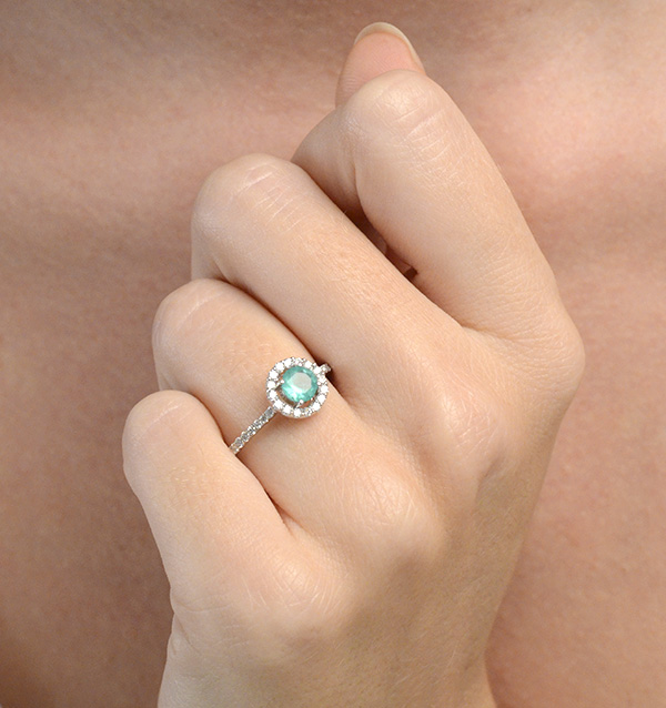 These are the 10 best emerald rings in the UK - emerald diamond halo ring