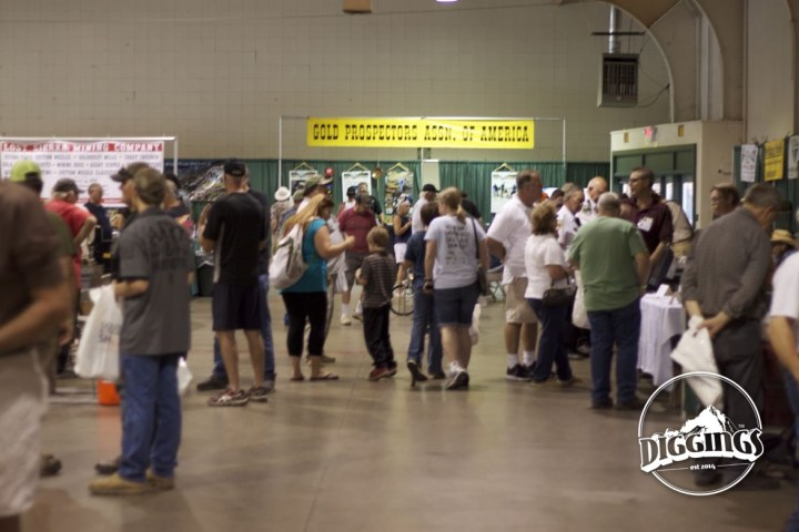 Attendees meander down the vendor aisles, past the Gold Prospectors Association of America booth.