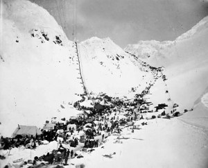 Miners travel the Chilkoot Pass along the Golden Stairs (left) or the Pederson Pass (right)