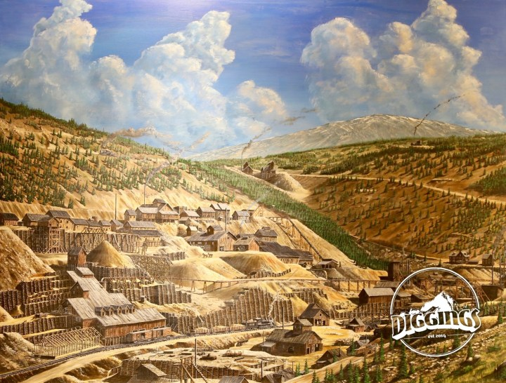 Fine art landscape portraying an open pit mine on display at the National Mining Hall of Fame & Museum
