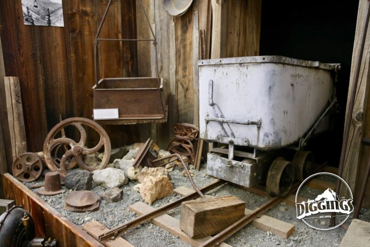 Ore cart, bucket, and assorted mining equipment at the Sumpter Museum And Public Library