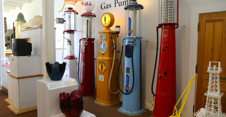 Display of vintage gas pumps and oil drills at the California Oil Museum