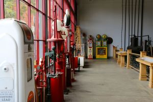 Assorted gas station pumps and other related tools lined up along the walls of the rig room in the California Oil Museum.