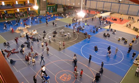 Youth wrestlers warm up