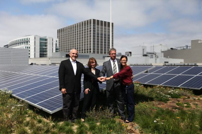 Atop 50 U.N. Plaza (from left) are John Rahim, director of the San Francisco Planning Department; Ruth Cox, GSA Regional Administrator, Pacific Rim Region; Stephen Peck, president of Green Roofs for Healthy Cities; and Juliet Ellis, assistant general manager for External Affairs at SFPUC.