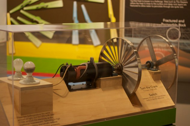 Interactive display explaining how turbines convert steam into electric power.